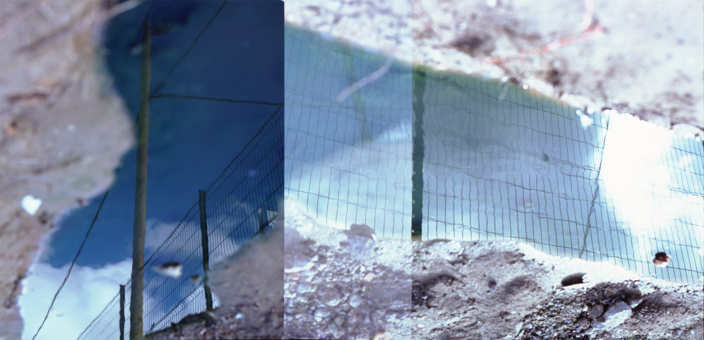 Calais the jungle refugees camp-fence-reflection